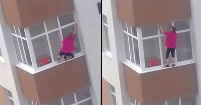 Отчаянная домохозяйка моет окна на 5 этаже, стоя снаружи без страховки. Это ж как надо любить чистоту!
