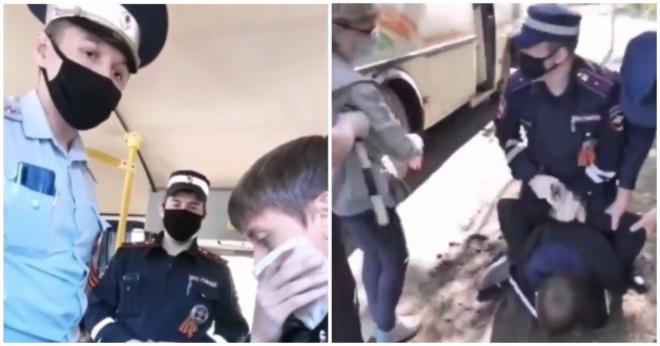 Полицейские выволокли мужчину из автобуса и заковали в наручники из-за отсутствия маски